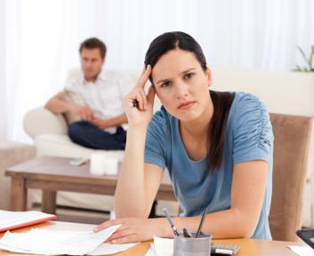 worried-woman-paperwork_476x290-higher